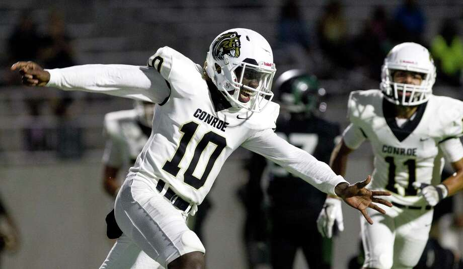 Conroe quarterback Jay Smith (10) reacts after running for a 7-yard touchdown during the fourth quarter of a non-district high school football game at Legacy Stadium on Saturday, Sept. 1, 2018, in Katy. Conroe defeated Mayde Creek 37-22. Photo: Jason Fochtman, Houston Chronicle / Staff Photographer / © 2018 Houston Chronicle