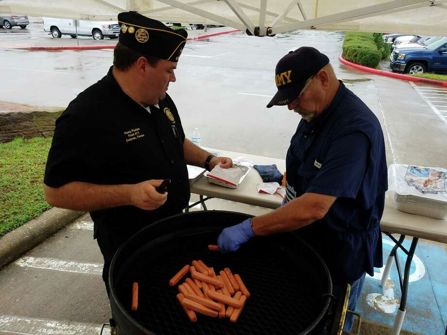 Conroe American Legion Post 411 members Huey Phelps and Jim Anderson prepare hot dogs during their annual Labor Day event on Sept. 3, 2018. Photo: Jennifer Summer