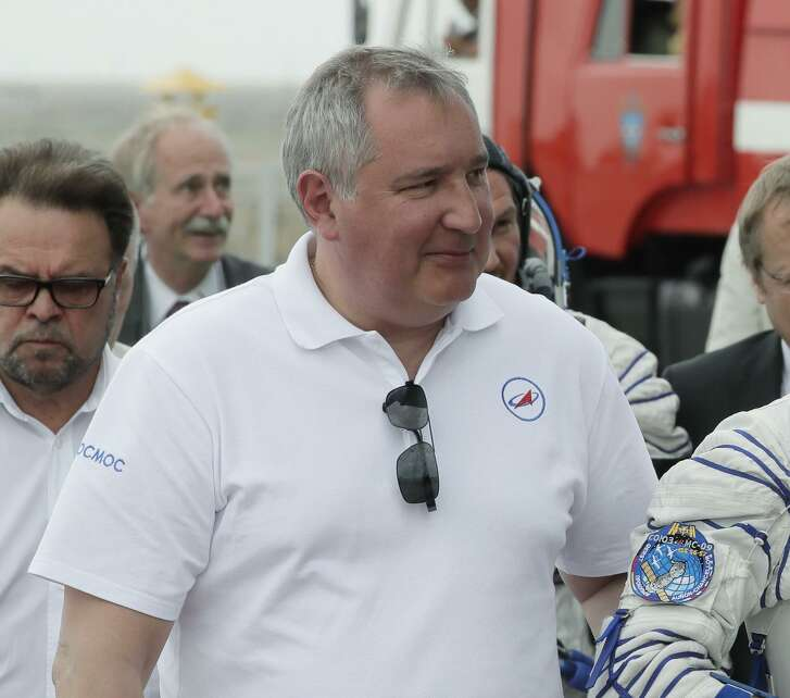 Roscosmos state space corporation head Dmitry Rogozin, accompanies new International Space Station crew members, to the rocket prior the launch at the Russian leased Baikonur Cosmodrome, in Kazakhstan in this June 6, 2018, image. Russian news agencies on Tuesday Sept. 4, quoted Rogozin saying that the hole was drilled by an unsteady hand potentially during manufacturing.