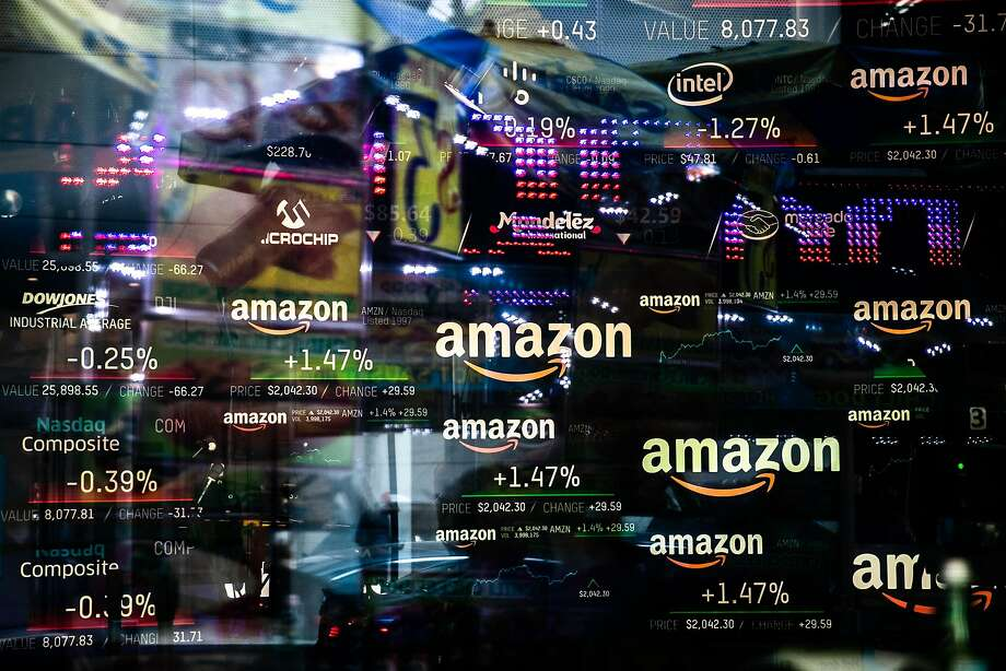 A monitor displays Amazon.com stock information at the Nasdaq MarketSite in New York. Amazon briefly became the second trillion-dollar company after adding $434 billion to its market capitalization. Photo: Jeenah Moon / Bloomberg