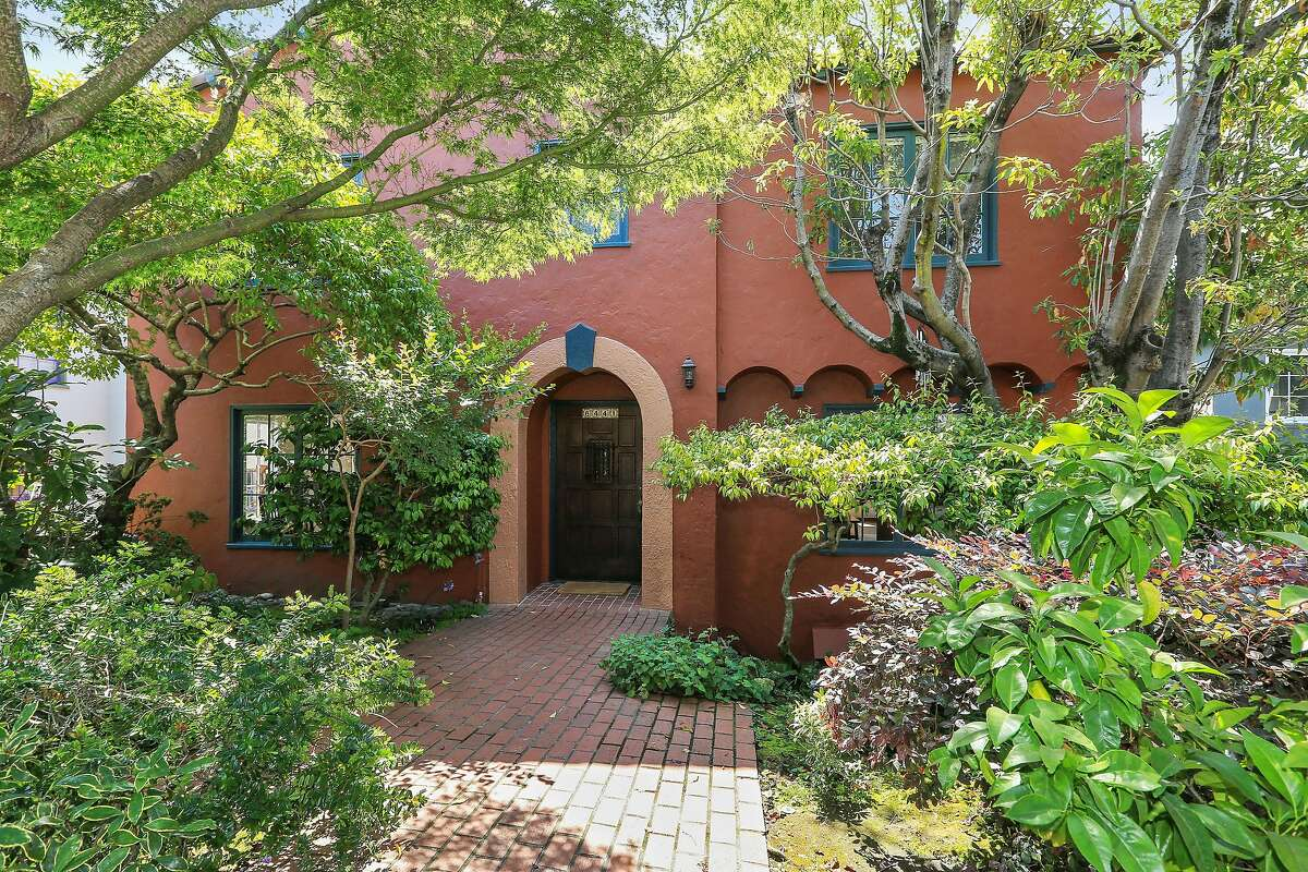 A brick pathway stretches before the Oakland home built in 1931.