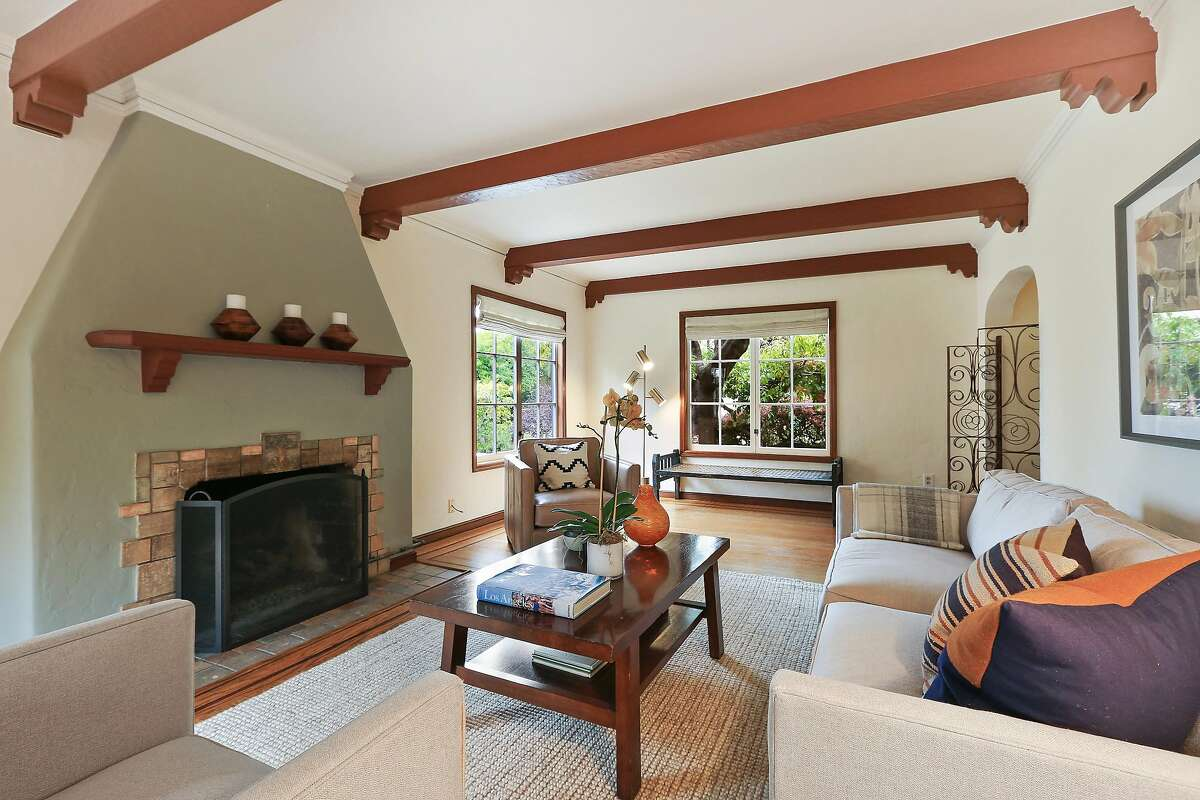 The living room features windows on three sides.