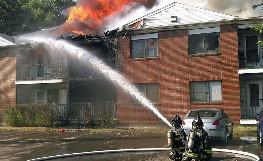 Firefighters battle a fire at Success Hill Condominiums, a 30-unit condo complex in Stratford on Aug. 29, 2018. The Connecticut Red Cross said it was helping 16 families. Donations of food and clothing are being collected at  Sterling House Community Center at 2283 Main Street. Photo: Bridgeport Fire Department / Contributed Photo / Connecticut Post Contributed