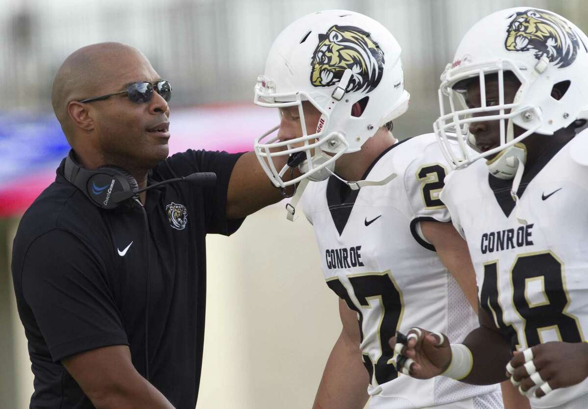 Conroe is among the area football teams outfitted by Nike, as evidenced by the swoosh on head coach Cedric Hardeman's shirt and the uniforms of his players.