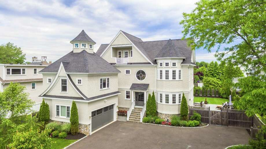 The contemporary colonial at 26 Edward St. in Fairfield is just steps from the beach with unobstructed views of Penfield lighthouse. Photo: The Higgins Group / ONLINE_CHECK