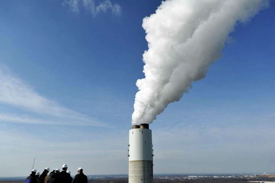 A group visiting Constellation Energy's coal-fired Brandon Shores Power Plant watches water vapor being released from a scrubber in Anne Arundel County, Md., on Jan. 5, 2012. The Trump administrations rewrite of Obama-era environmental regulations could give new life to coal plants that have not installed advanced pollution controls. Photo: SHANNON JENSEN /NYT / NYTNS