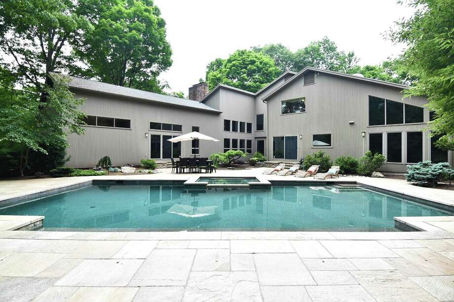 The dramatically designed contemporary-style home at 9 Stonehenge Place in Cheshire features a spa and heated swimming pool. Photo: William Raveis Real Estate / ONLINE_CHECK