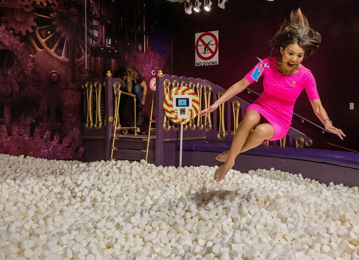ABC7 News reporter Dion Lim jumps into a pit filled with 250,000 marshmallows at Candytopia in San Francisco, Calif. Tuesday, Sept. 4, 2018.