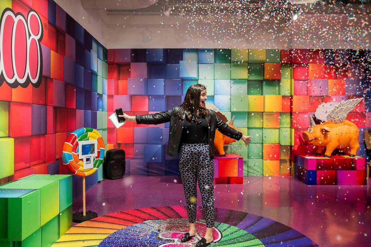 Carrie Bernstein is doused in confetti while standing on a spinning platform at Candytopia in San Francisco, Calif. Tuesday, Sept. 4, 2018.