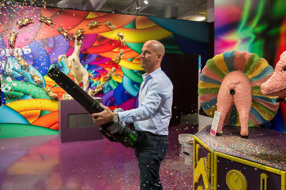 Candytopia co-founder John Goodman uses a leaf blower to spray confetti at Candytopia in San Francisco, Calif. Tuesday, Sept. 4, 2018.