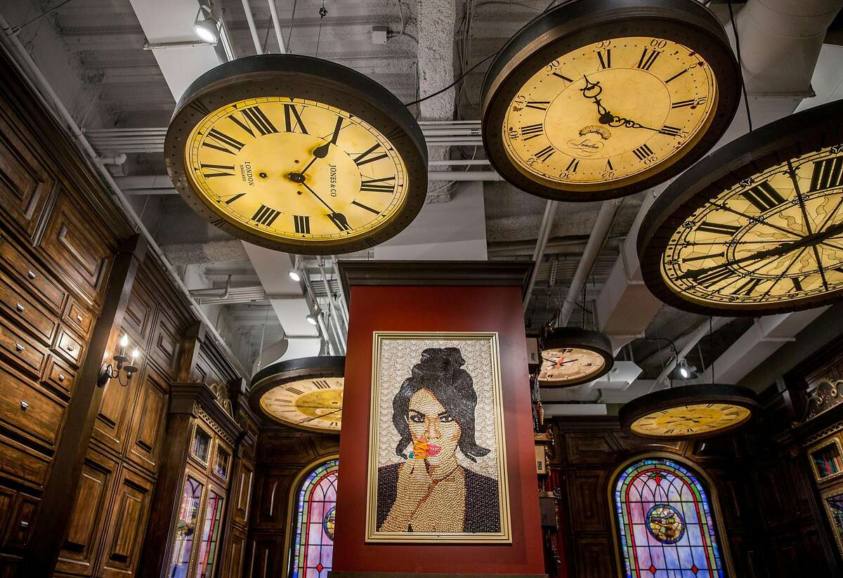 A candy portrait of Candytopia co-founder Jackie Sorkin sits under large clocks in the Library Room of Candytopia in San Francisco, Calif. Tuesday, Sept. 4, 2018.