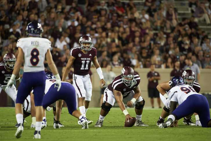 COLLEGE STATION, TX - AUGUST 30:  Kellen Mond #11 of the Texas A&M Aggies calls a play at the line of scrimmage against the Northwestern State Demons during the first half of a football game at Kyle Field on August 30, 2018 in College Station, Texas.  (Photo by Cooper Neill/Getty Images)