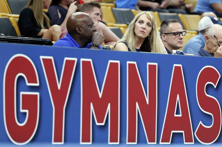 FILE - In this Aug. 16, 2018, file photo, USA Gymnastics President and CEO Kerry Perry, middle, watches the U.S. Gymnastics Championships, in Boston. Kerry Perry has resigned as president of USA Gymnastics. The announcement Tuesday, Sept. 4, 2018, came days after the United States Olympic Committee questioned the direction of the organization under Perry's leadership. (AP Photo/Elise Amendola, File)