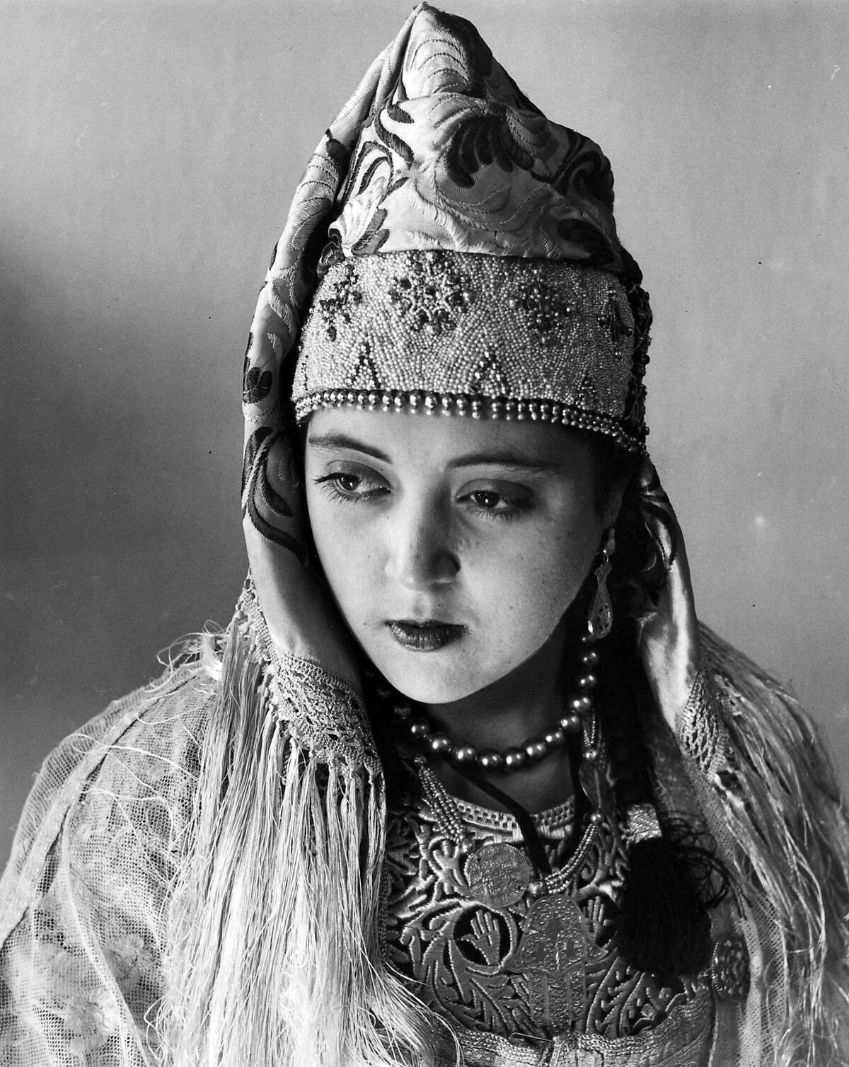Woman wearing a pearled swalf. Fez, Morocco, 1930s. Photographic Archive of The Isidore and Anne Falk Information Center for the Jewish Art and Life, The Israel Museum, Jerusalem. Photo � J. Besancenot. Veiled Meanings: Fashioning Jewish Dress, from the Collection of The Israel Museum, Jerusalem on view August 30, 2018�January 6, 2019 at The Contemporary Jewish Museum, San Francisco.