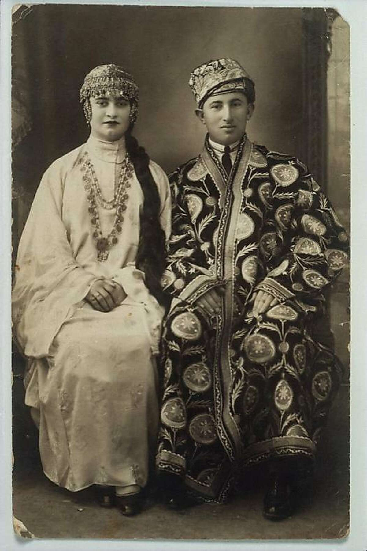 David and Rina Davidoff, after their betrothal dressed in Bukharan traditional festive attire. Jerusalem, 1927. Photographic Archive of The Isidore and Anne Falk Information Center for the Jewish Art and Life, The Israel Museum, Jerusalem. Courtesy Dan Meiry, Haifa. Veiled Meanings: Fashioning Jewish Dress, from the Collection of The Israel Museum, Jerusalem on view August 30, 2018�January 6, 2019 at The Contemporary Jewish Museum, San Francisco.