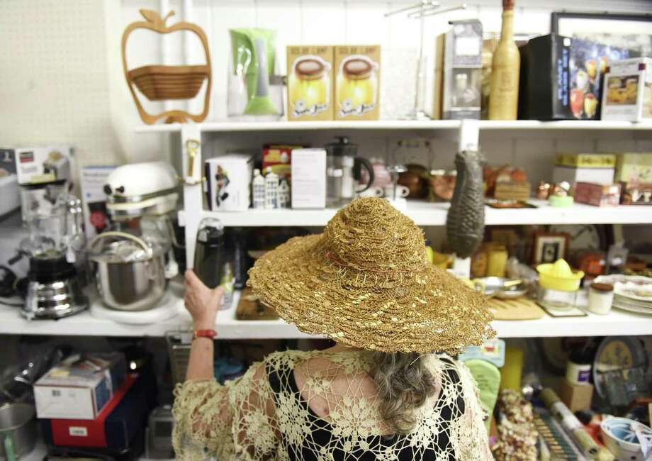 Myrna Hollinger, of Stamford, browses knick knacks for sale during the 54th grand re-opening at the Rummage Room in Old Greenwich, Conn. Tuesday, Sept. 4, 2018. As per usual, the shop was closed for the last month and just re-opened with shelves stocked with new items. The shop, operated by the Women's Fellowship of the First Congregational Church of Greenwich, supports local, national and international nonprofit organizations. Photo: Tyler Sizemore / Hearst Connecticut Media / Greenwich Time