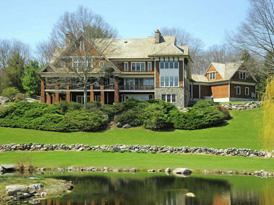 The contemporary colonial at 23 Carrington Drive in Greenwich is on 23.4 acres with two ponds and a barn with 12 stalls. The June Hill Farm property includes another house at 242 June Road in Stamford. The entire horse farm is listed for $9.950 million. Photo: William Pitt Sotheby's International Realty / ONLINE_CHECK