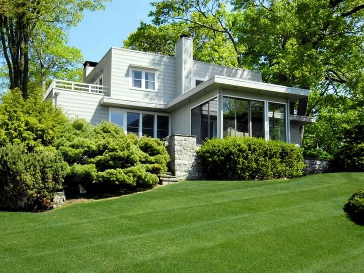 The 23.4-acre June Hill Farm property includes another house, a contemporary at 242 June Road in Stamford.