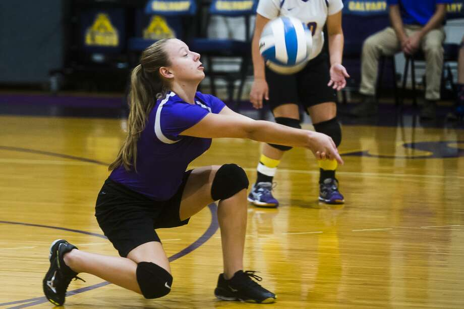 Calvary Baptist senior Courtney Warner bumps the ball during a match against Clinton Faith on Tuesday, Sept. 4, 2018 at Calvary Baptist Academy. (Katy Kildee/kkildee@mdn.net) Photo: (Katy Kildee/kkildee@mdn.net)