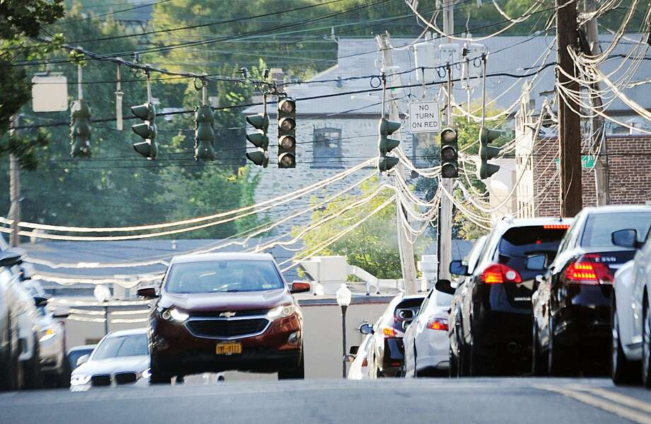 With the traffic lights not functioning due to a power outage, cars move slowly on Mill Street Tuesday, September 4, 2018.  Photo: Bob Luckey Jr. / Hearst Connecticut Media / Greenwich Time