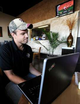 James Jessup talks about his fantasy football league at Major League Grill in Beaumont, Thursday. Jessup also has a baseball league and gets involved in March Madness pools. Tammy McKinley/The Enterprise