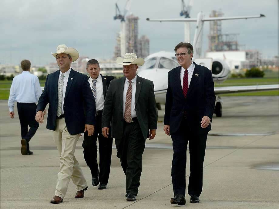 Lt. Governor Daniel Patrick talks with Texas Rangers Ryan Clendennen (far left) and Brandon Bess as he makes his way into the main gate during his stop at the Beaumont Municipal Airport Tuesday. Patrick later addressed issues including school security, education and job growth during his visit, which was one of several city stops in the region as he and Governor Greg Abbott campaign for re-election. Tuesday, September 04, 2018 Kim Brent/The Enterprise Photo: Kim Brent / The Enterprise / BEN