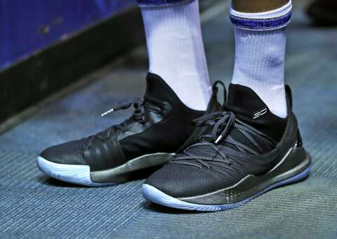0d3ea0f236b7 Golden State Warriors  Stephen Curry wears his new Under Armour Curry 5  shoes before Warriors