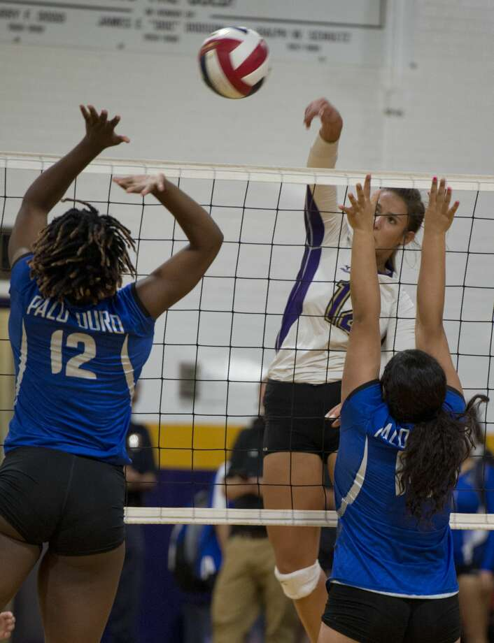 Midland High's Hayley Branco puts the ball between Palo Duro players #12,Tamera D. and #14, Naomi S.  09/04/18 at MHS Gym. Tim Fischer/Reporter-Telegram Photo: Tim Fischer/Midland Reporter-Telegram