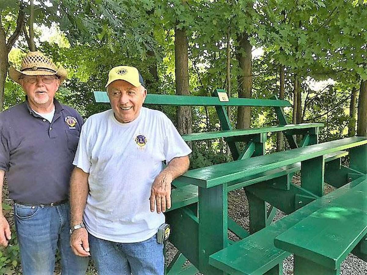 Lions Jim Bannan, left, and Frank Cavaliero, proudly stand beside the completed project.