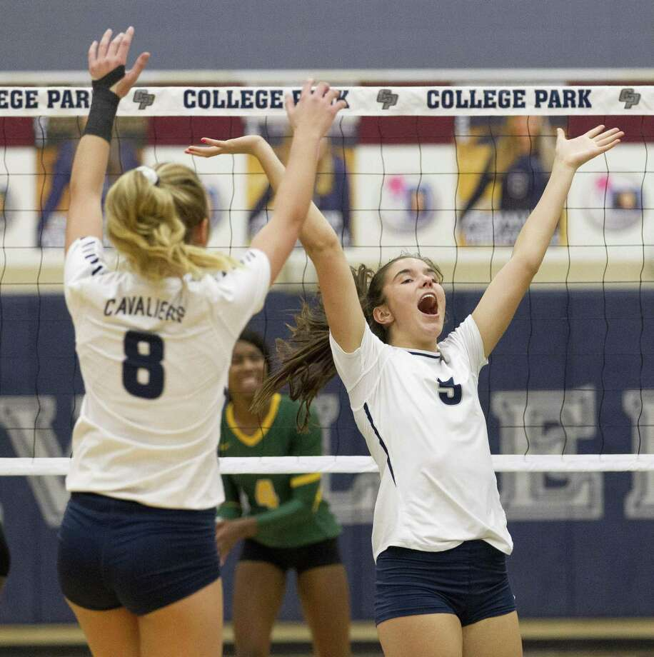 College Park's Abby Kremer (5) reacts after a block beside Caleb Caffey (8) during the second set of a District 15-6A high school volleyball match at College Park High School on Tuesday, Sept. 4, 2018, in The Woodlands. Photo: Jason Fochtman, Houston Chronicle / Staff Photographer / © 2018 Houston Chronicle