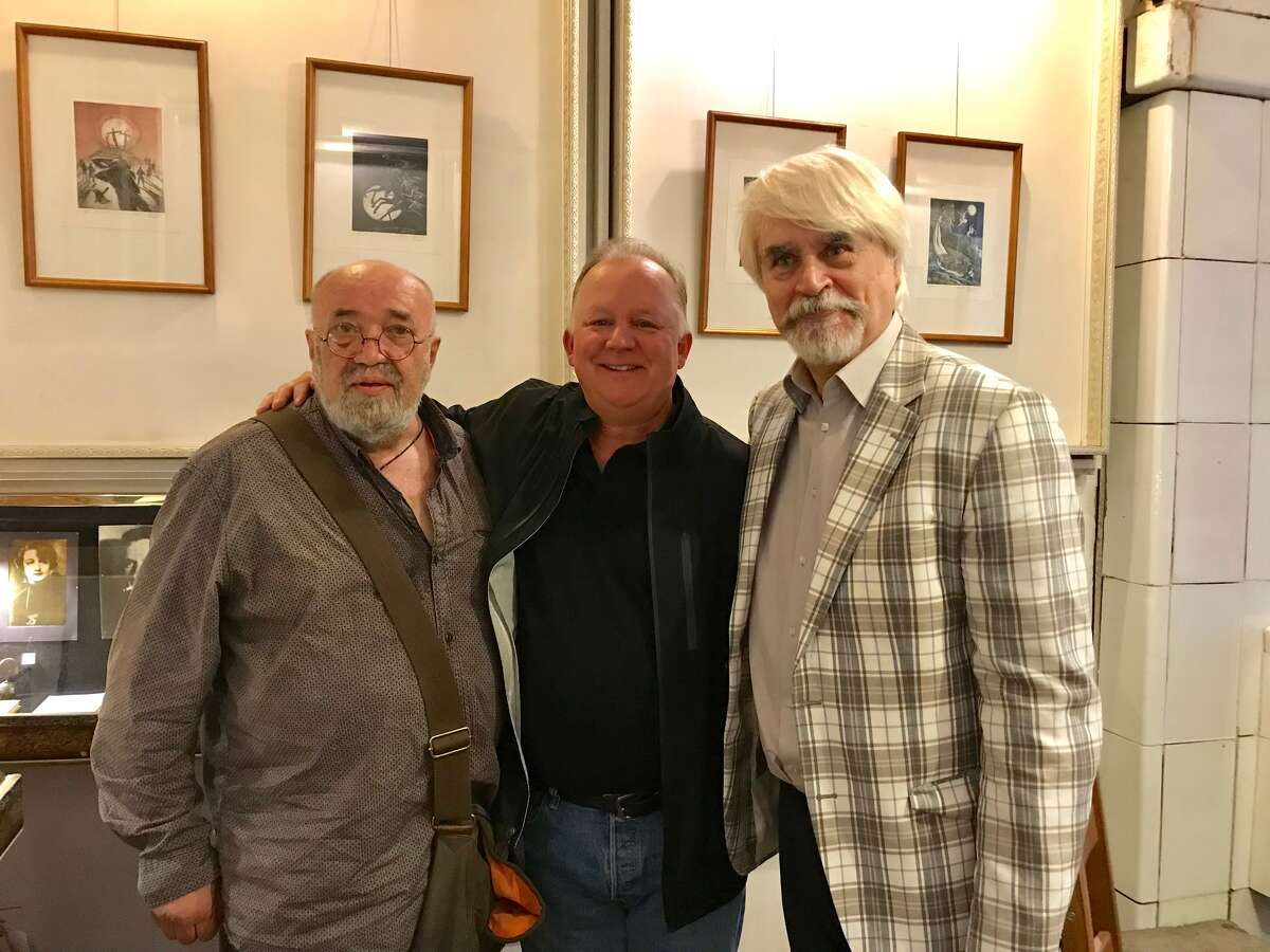 Yevgeny Popov, left, and Boris Evseev, Russian dissident writers and leaders of the Union of Russian Writers, flank Paul Grondahl. (Mary Grondahl /Special to the Times Union)