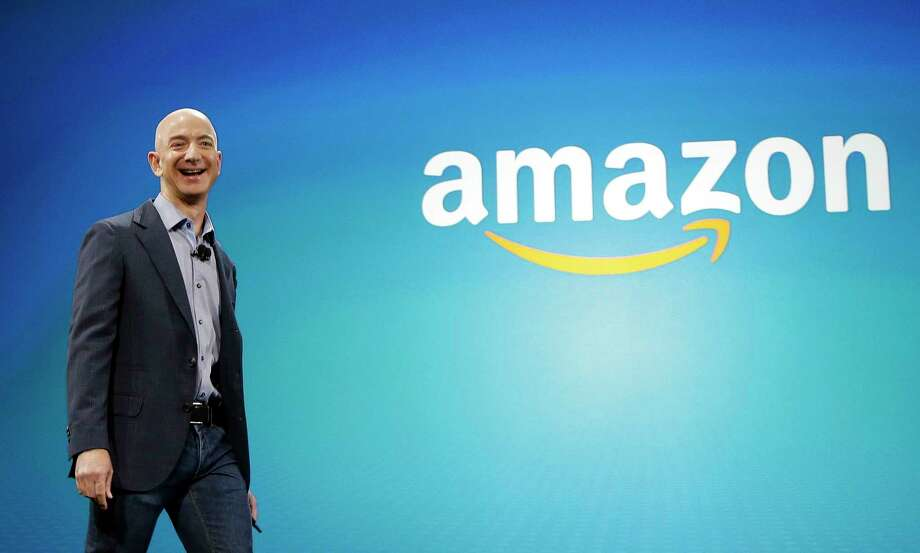 FILE - In this June 16, 2014, file photo, Amazon CEO Jeff Bezos walks onstage for the launch of the new Amazon Fire Phone, in Seattle.  Photo: Ted S. Warren / Copyright 2016 The Associated Press. All rights reserved. This m