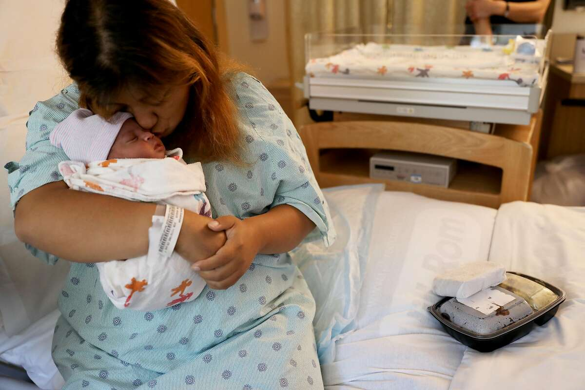 Guadalupe Ramirez, 25, kisses her newborn daughter, Valentina Latrena Marie Crosley, at the University of California San Francisco Mission Bay Women's Hospital in San Francisco, Calif., on Tuesday, September 4, 2018. A new study will be released Wednesday in Health Affairs that aims to explain how California was able to cut down on its maternal death rate even as the rate for the rest of the country rose.