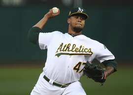 Oakland Athletics pitcher Frankie Montas works against the Seattle Mariners in the first inning of a baseball game Thursday, Aug. 30, 2018, in Oakland, Calif. (AP Photo/Ben Margot)