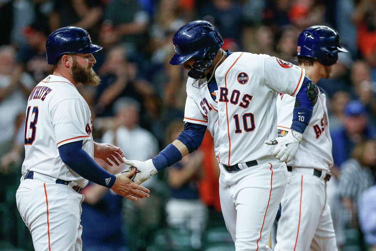 Houston Astros first baseman Yuli Gurriel (10) celebrates his two-run home run during the first inning with second baseman Tyler White (13) as the Houston Astros take on the Minnesota Twins at Minute Maid Park Tuesday Sept. 4, 2018 in Houston.