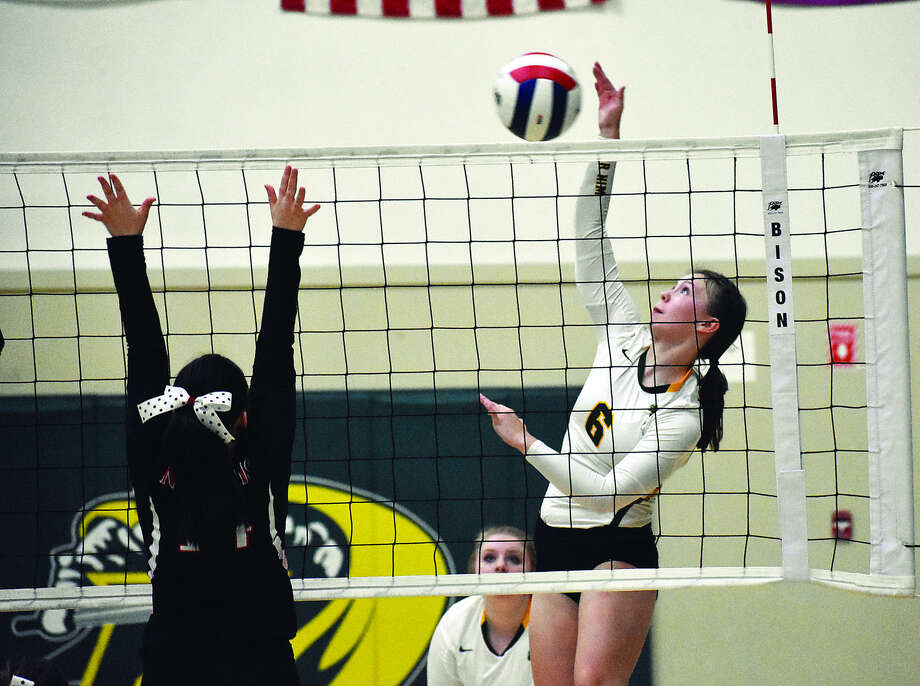 Metro-East Lutheran outside hitter Anne Kienle slams down one of her match-high seven kills during the second  game against Nokomis on Tuesday. Photo: Matthew Kamp