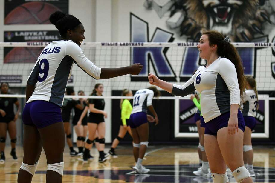Willis senior De'Janae Gilmore, left, and junior Erin Bond get pumped up before the start of the third game against Huntsville in their District 8-5A matchup at Willis High School on Tuesday, Sept. 4, 2018. Photo: Jerry Baker, Houston Chronicle / Contributor / Houston Chronicle