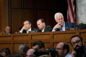 From left: Sens. Ted Cruz (R-Texas), Mike Lee (R-Utah) and John Cornyn (R-Texas) listen as the confirmation hearing for Brett Kavanaugh, President Donald Trump's nominee for the U.S. Supreme Court, was underway before the Senate Judiciary Committee on Capitol Hill, in Washington, Sept. 4, 2018. (Erin Schaff/The New York Times)