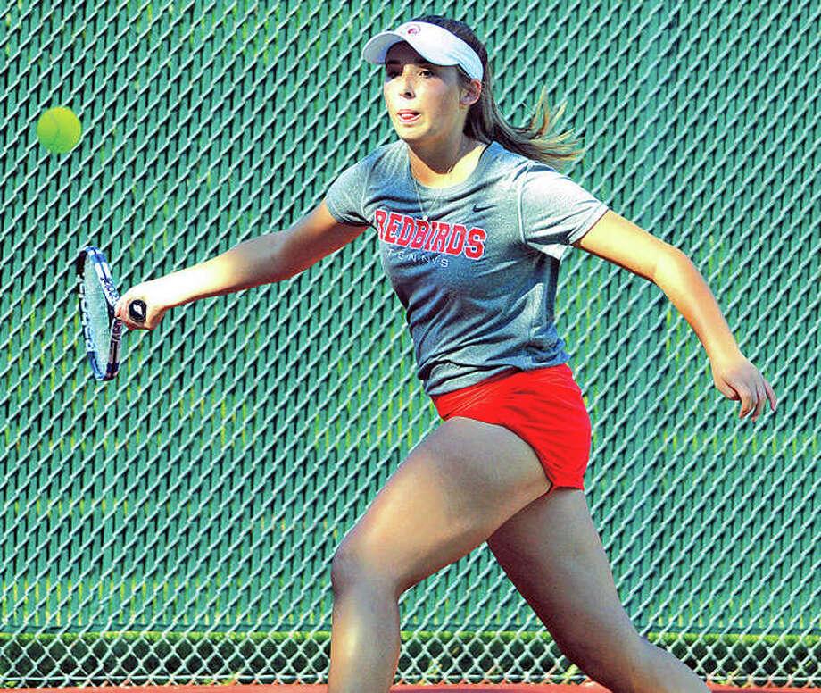 Alton senior Cali Giertz makes a forehand return during her No. 4 singles match against Edwardsville's Chloe Trimpe Tuesday at Edwardsville. Photo: Scott Marion | For The Telegraph