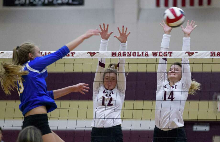 FILE PHOTO — Magnolia West's Kara Wilson (12) and Kyndall Eddlemon (14) defend against Klein's Annie Antar (13) during the first set of a non-district volleyball match at Magnolia West High School on Wednesday, Aug. 15, 2018, in Magnolia Photo: Jason Fochtman, Staff Photographer / Staff Photographer / © 2018 Houston Chronicle