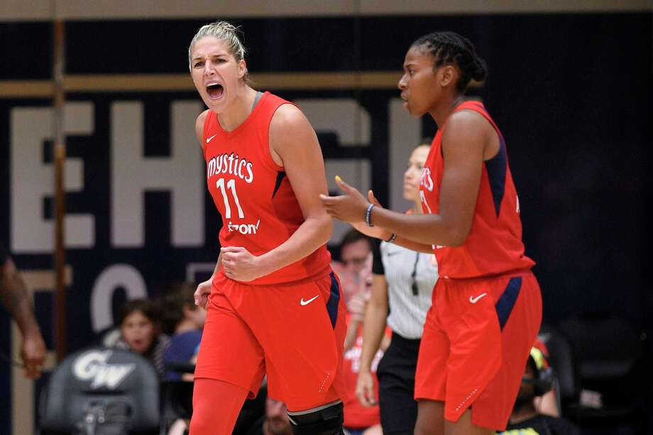 Washington Mystics forward Elena Delle Donne (11) reacts next to Ariel Atkins, right, during the second half of Game 4 of a WNBA basketball playoffs semifinal against the Atlanta Dream, Sunday, Sept. 2, 2018, in Washington. (AP Photo/Nick Wass) Photo: Nick Wass, Associated Press / Copyright 2018 The Associated Press. All rights reserved.