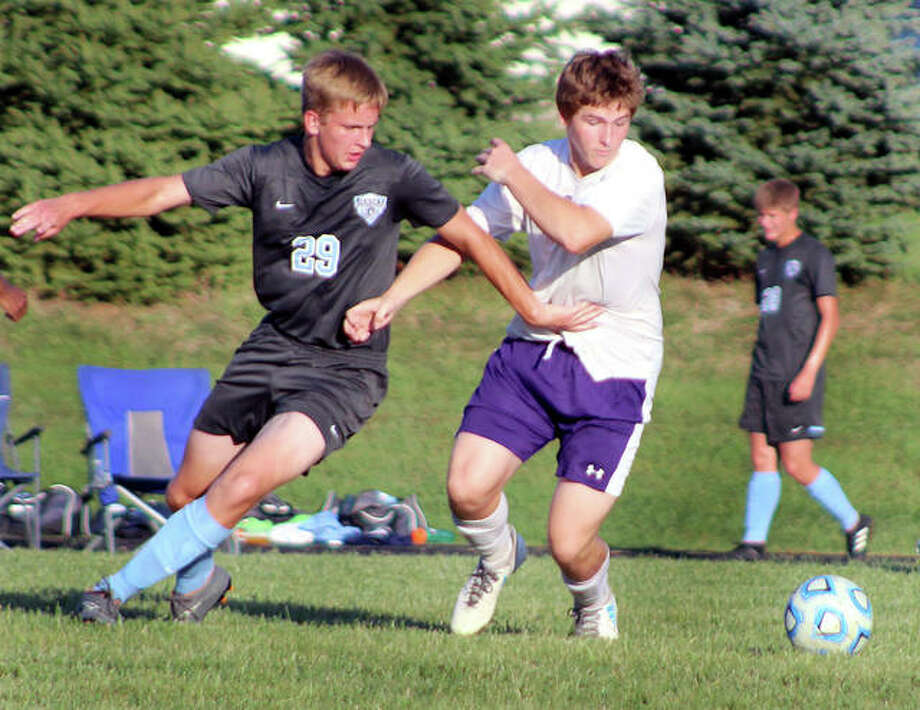 Jersey's Andrew Kribs (29) and Cole Gober of Mascoutah go for the ball during Mississippi Valley Conference action Tuesday evening in Jerseyville. Mascoutah handed the Panthers their first loss of the season, 1-0. Photo: Pete Hayes | The Telegraph