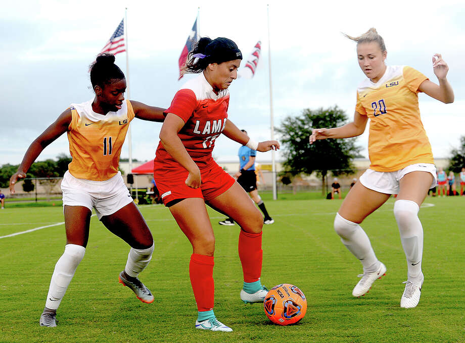 Lamar's Juliana Ocampo looks to maneuver the ball past the pressure of LSU's Tinaya Alexander (left) and Marlena Cutura during Tuesday's home game.