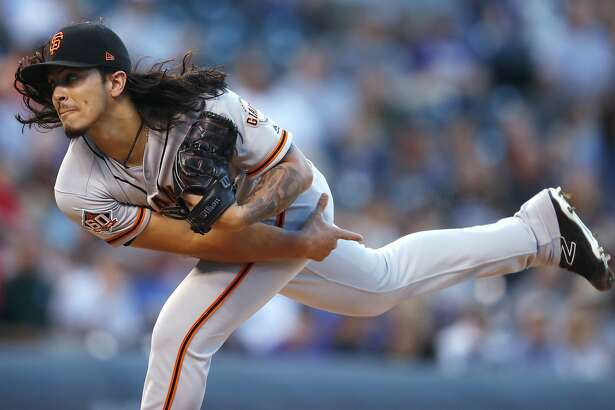 San Francisco Giants starting pitcher Dereck Rodriguez follows through on a delivery to a Colorado Rockies batter during the first inning of a baseball game Tuesday, Sept. 4, 2018, in Denver. (AP Photo/David Zalubowski)