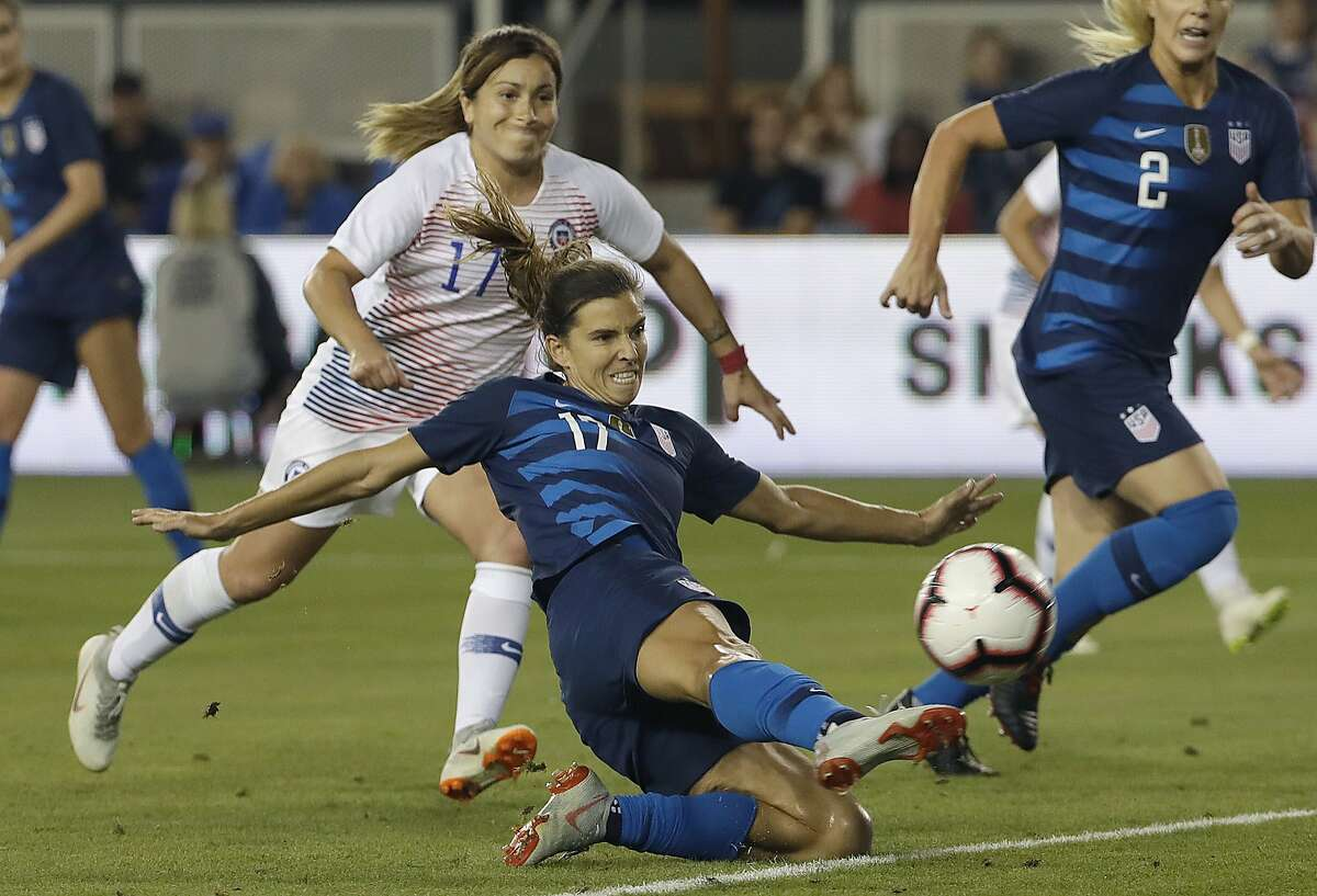 United States' Tobin Heath, bottom, scores a goal in front of Chile's Geraldine Leyton during the first half of an international friendly soccer match in San Jose, Calif., Tuesday, Sept. 4, 2018. (AP Photo/Jeff Chiu)