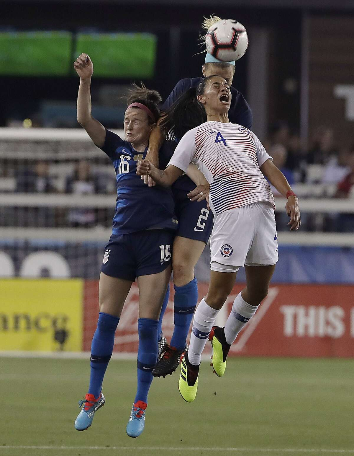 Chile's Francisca Lara (4) jumps for the ball in front of United States' Rose Lavelle, left, and Julie Ertz during the first half of an international friendly soccer match in San Jose, Calif., Tuesday, Sept. 4, 2018. (AP Photo/Jeff Chiu)