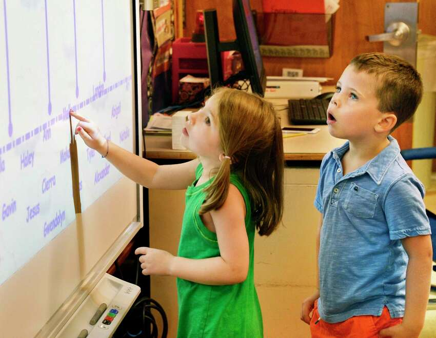 Kindergarteners Mallory Sinel, left, and Tyler Rhodes get acquainted with their classroom smart board during Kindergarten Orientation at Division Street Elementary School Tuesday Sept. 4, 2018 in Saratoga Springs, NY. (John Carl D'Annibale/Times Union)