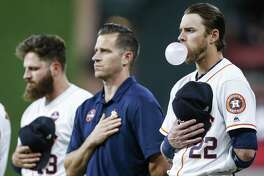 Houston Astros right fielder Josh Reddick (22) blows a bubble during the national anthem before the first inning as the Houston Astros take on the Minnesota Twins at Minute Maid Park Tuesday Sept. 4, 2018 in Houston.