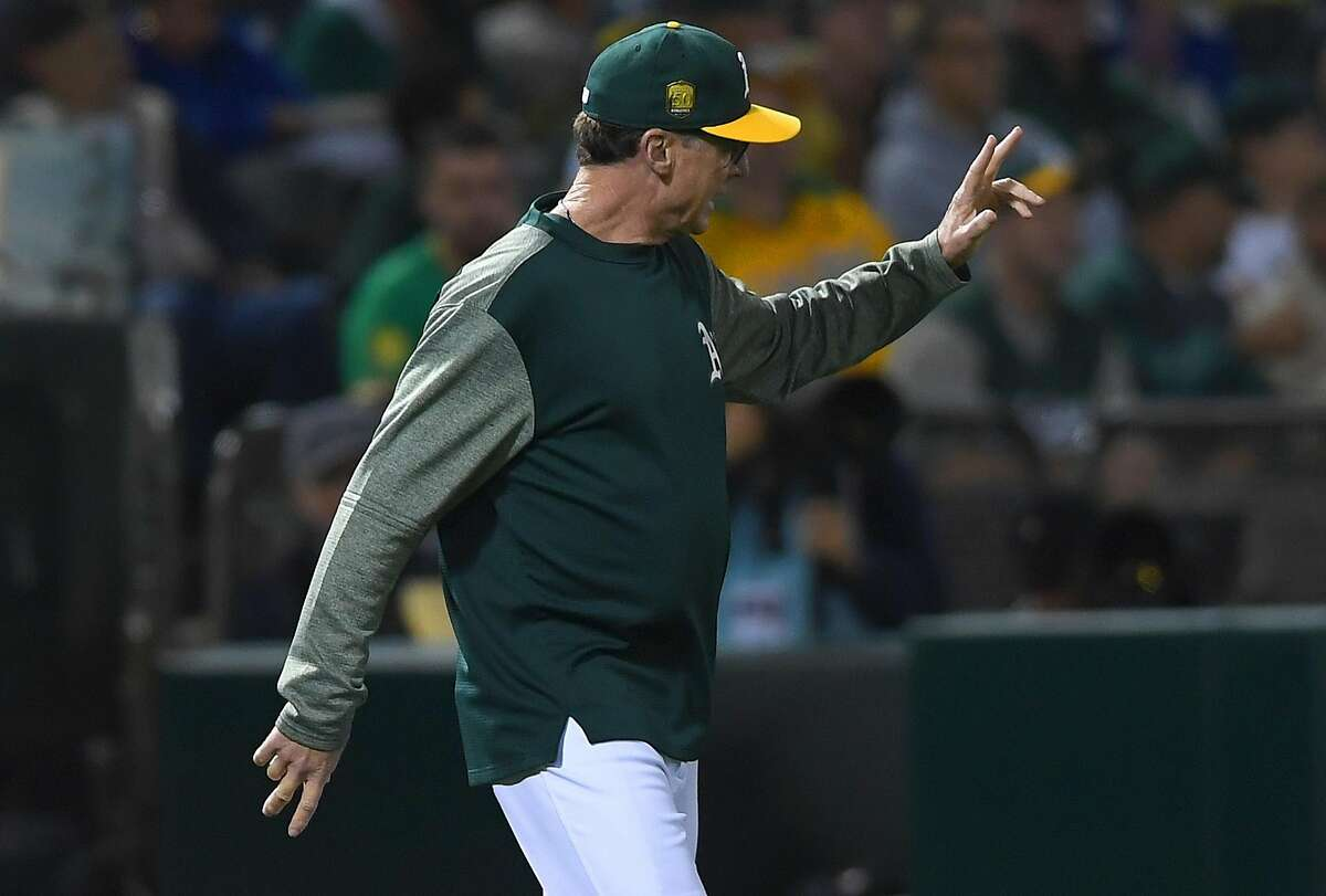 OAKLAND, CA - SEPTEMBER 04: Manager Bob Melvin #6 of the Oakland Athletics comes out of the dugout and signals the bullpent to make a pitching change against the New York Yankees in the top of the six inning at Oakland Alameda Coliseum on September 4, 2018 in Oakland, California. (Photo by Thearon W. Henderson/Getty Images)