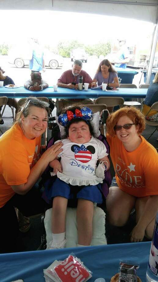 Nadine Barkley (left) and Dusty Chamberlin with a Make a Wish child at a previous Wish a Mile Bicycle Tour. (Photo provided)